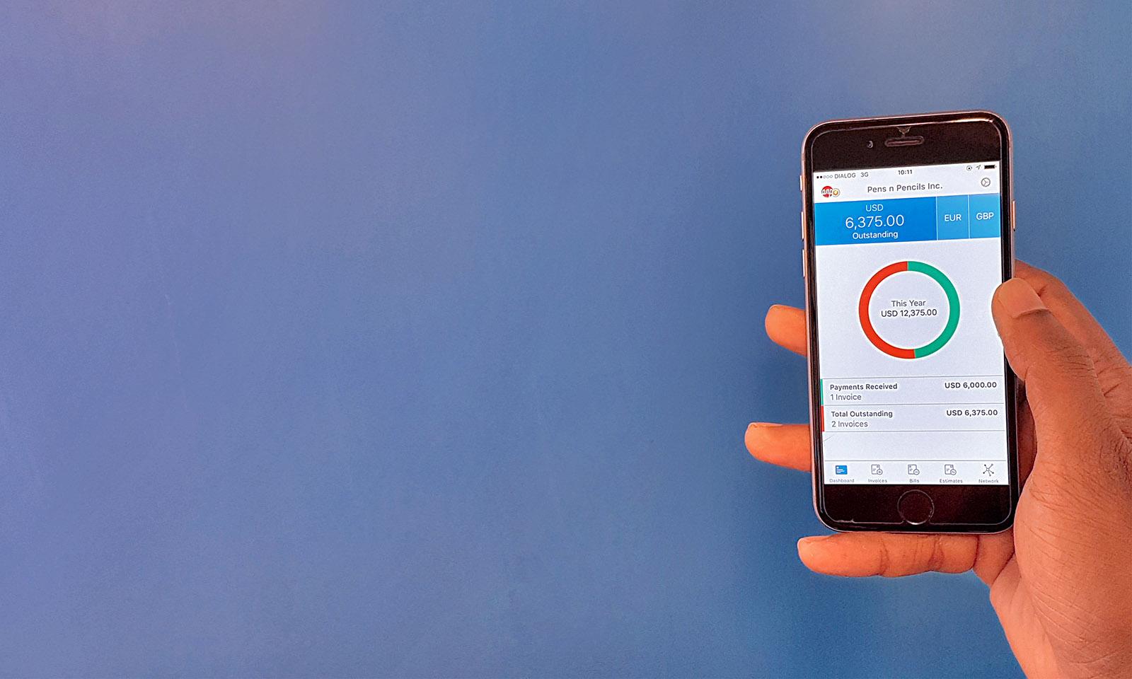 Hiveage iOS app in hand